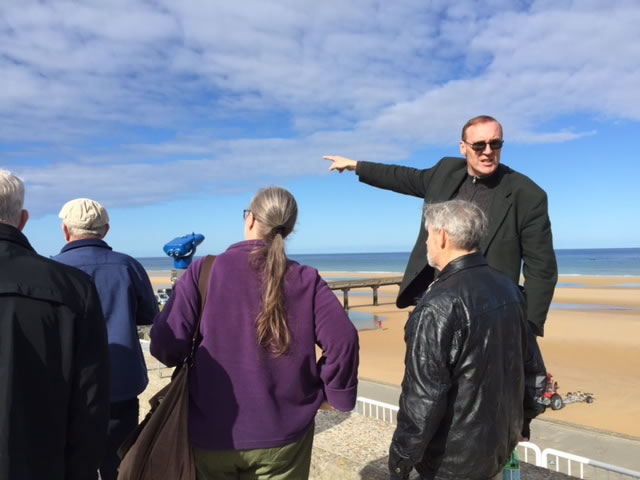 Ken Chase With Tour Group at D Day Beaches